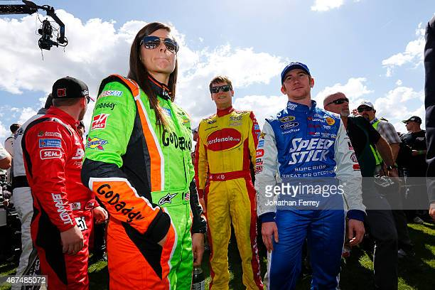 Danica Patrick driver of the GoDaddy Chevrolet and Cole Whitt driver of the Speed Stick Ford stands on the grid during the NASCAR Sprint Cup Series...