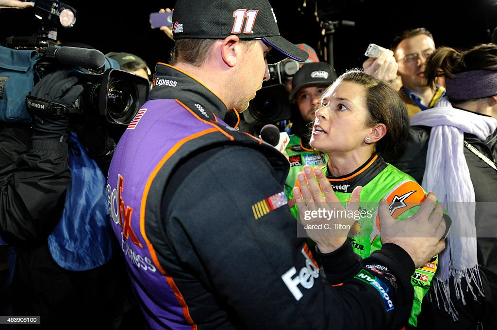 Danica Patrick, driver of the #10 GoDaddy Chevrolet, and Denny Hamlin, driver of the #11 FedEx Express Toyota, talk about their in-race incident on pit road after the the NASCAR Sprint Cup Series Budweiser Duel 2 at Daytona International Speedway on February 19, 2015 in Daytona Beach, Florida.