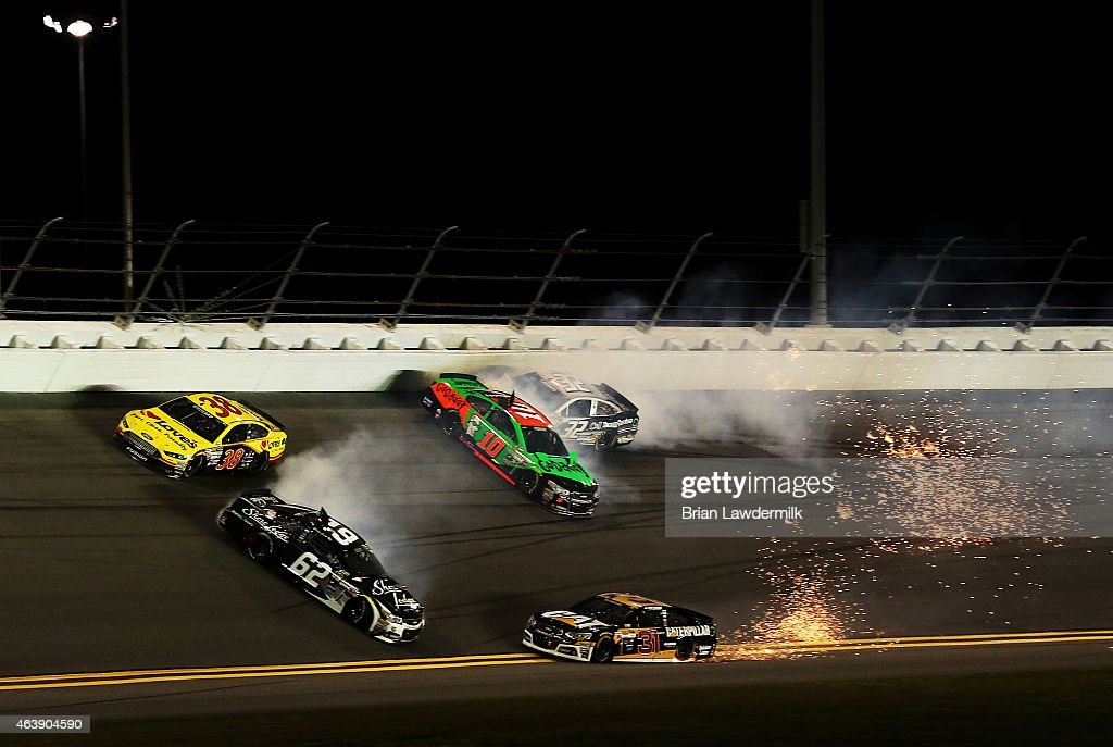 Danica Patrick, driver of the #10 GoDaddy Chevrolet, Brian Scott, driver of the #62 Shore Lodge Chevrolet, and Ryan Newman, driver of the #31 Caterpillar Chevrolet, are involved in an on-track incident during the NASCAR Sprint Cup Series Budweiser Duel 2 at Daytona International Speedway on February 19, 2015 in Daytona Beach, Florida.