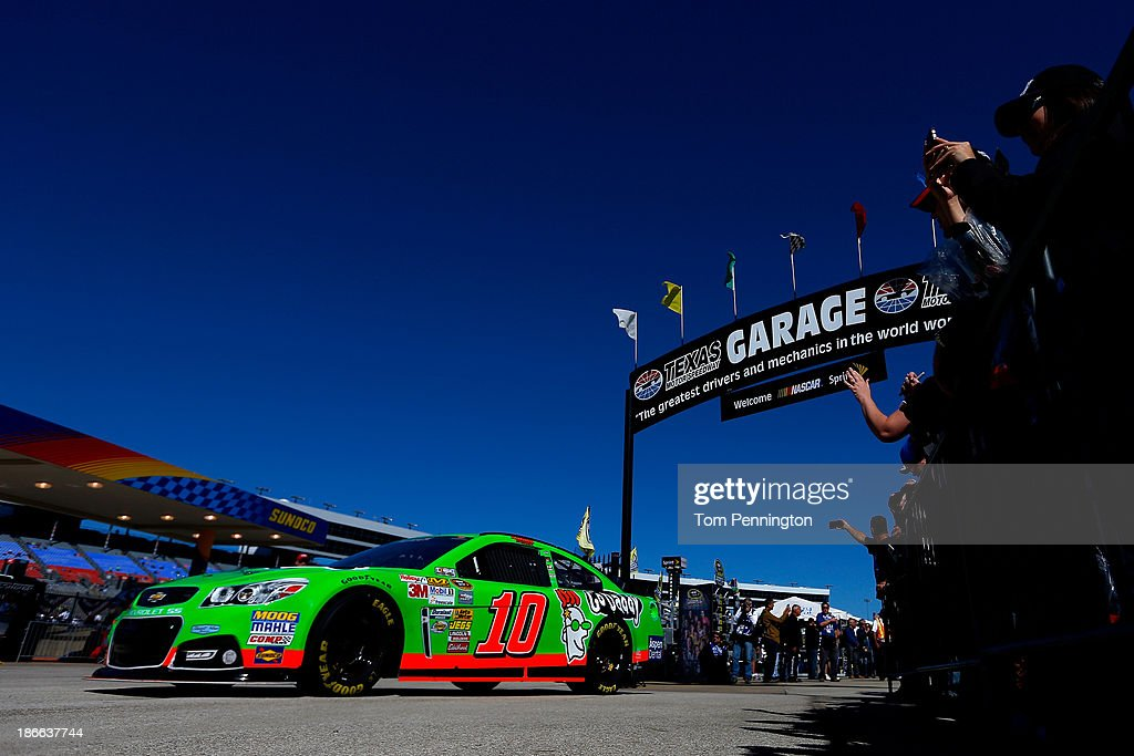 <a gi-track='captionPersonalityLinkClicked' href=/galleries/search?phrase=Danica+Patrick&family=editorial&specificpeople=183352 ng-click='$event.stopPropagation()'>Danica Patrick</a>, driver of the #10 GoDaddy Chevrolet, drives out of the garage during practice for the NASCAR Sprint Cup Series AAA Texas 500 at Texas Motor Speedway on November 2, 2013 in Fort Worth, Texas.