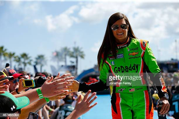 Danica Patrick driver of the GoDaddy Chevrolet greets fans during the NASCAR Sprint Cup Series 57th Annual Daytona 500 at Daytona International...