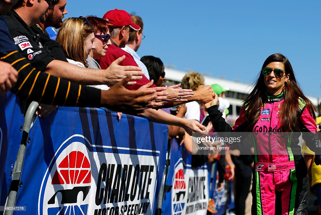 Danica Patrick driver of the GoDaddy Chevrolet greets fans prior to the NASCAR Sprint Cup Series Bank of America 500 at Charlotte Motor Speedway on...