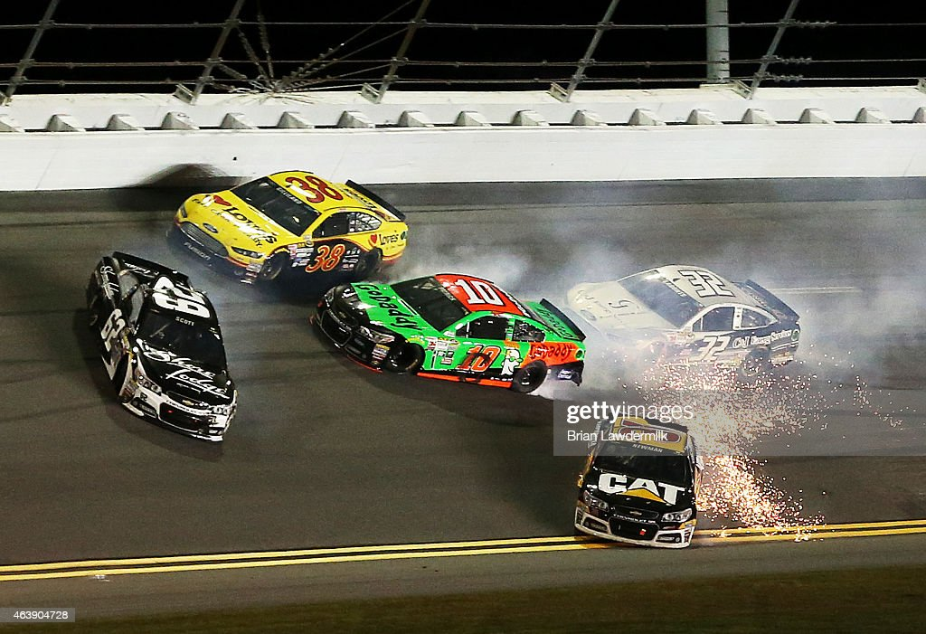 Danica Patrick, driver of the #10 GoDaddy Chevrolet, is involved in an on-track incident with Ryan Newman, driver of the #31 Caterpillar Chevrolet, and Brian Scott, driver of the #62 Shore Lodge Chevrolet, during the NASCAR Sprint Cup Series Budweiser Duel 2 at Daytona International Speedway on February 19, 2015 in Daytona Beach, Florida.