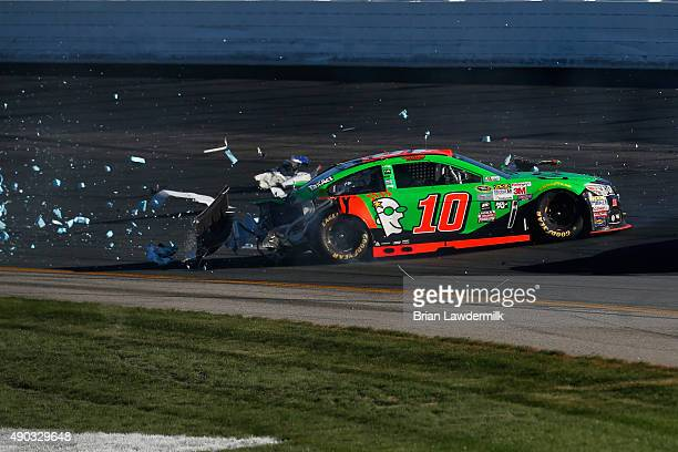 Danica Patrick driver of the GoDaddy Chevrolet is involved in an ontrack incident during the NASCAR Sprint Cup Series SYLVANIA 300 at New Hampshire...