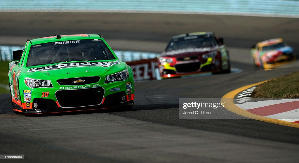 <a gi-track='captionPersonalityLinkClicked' href=/galleries/search?phrase=Danica+Patrick&family=editorial&specificpeople=183352 ng-click='$event.stopPropagation()'>Danica Patrick</a>, driver of the #10 GoDaddy Chevrolet, leads <a gi-track='captionPersonalityLinkClicked' href=/galleries/search?phrase=Jeff+Gordon&family=editorial&specificpeople=171491 ng-click='$event.stopPropagation()'>Jeff Gordon</a>, driver of the #24 Drive to End Hunger Chevrolet, and <a gi-track='captionPersonalityLinkClicked' href=/galleries/search?phrase=Kyle+Busch&family=editorial&specificpeople=211123 ng-click='$event.stopPropagation()'>Kyle Busch</a>, driver of the #18 M&M's Toyota, during practice for the NASCAR Sprint Cup Series Cheez-It 355 at Watkins Glen International on August 9, 2013 in Watkins Glen, New York.