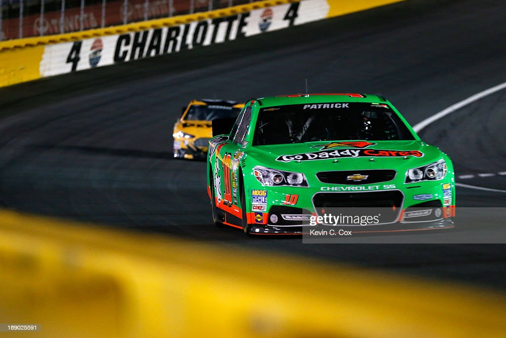 Danica Patrick, driver of the #10 GoDaddy Chevrolet, leads Marcos Ambrose, driver of the #9 DeWalt Ford, during the NASCAR Sprint Cup Showdown at Charlotte Motor Speedway on May 18, 2013 in Concord, North Carolina.