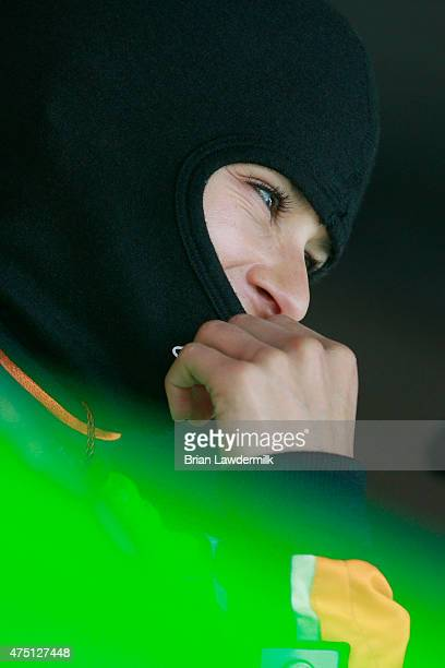 Danica Patrick driver of the GoDaddy Chevrolet looks on in the garage area during practice for the NASCAR Sprint Cup Series FedEx 400 Benefiting...