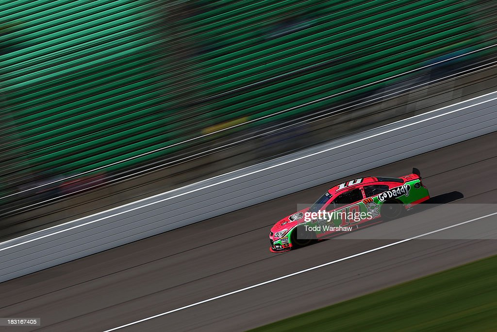 <a gi-track='captionPersonalityLinkClicked' href=/galleries/search?phrase=Danica+Patrick&family=editorial&specificpeople=183352 ng-click='$event.stopPropagation()'>Danica Patrick</a>, driver of the #10 GoDaddy Chevrolet, practices for the NASCAR Sprint Cup Series 13th Annual Hollywood Casino 400 at Kansas Speedway on October 5, 2013 in Kansas City, Kansas.