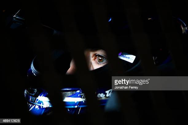 Danica Patrick driver of the GoDaddy Chevrolet sits in her car in the garage area during practice for the NASCAR Sprint Cup Series Sprint Unlimited...