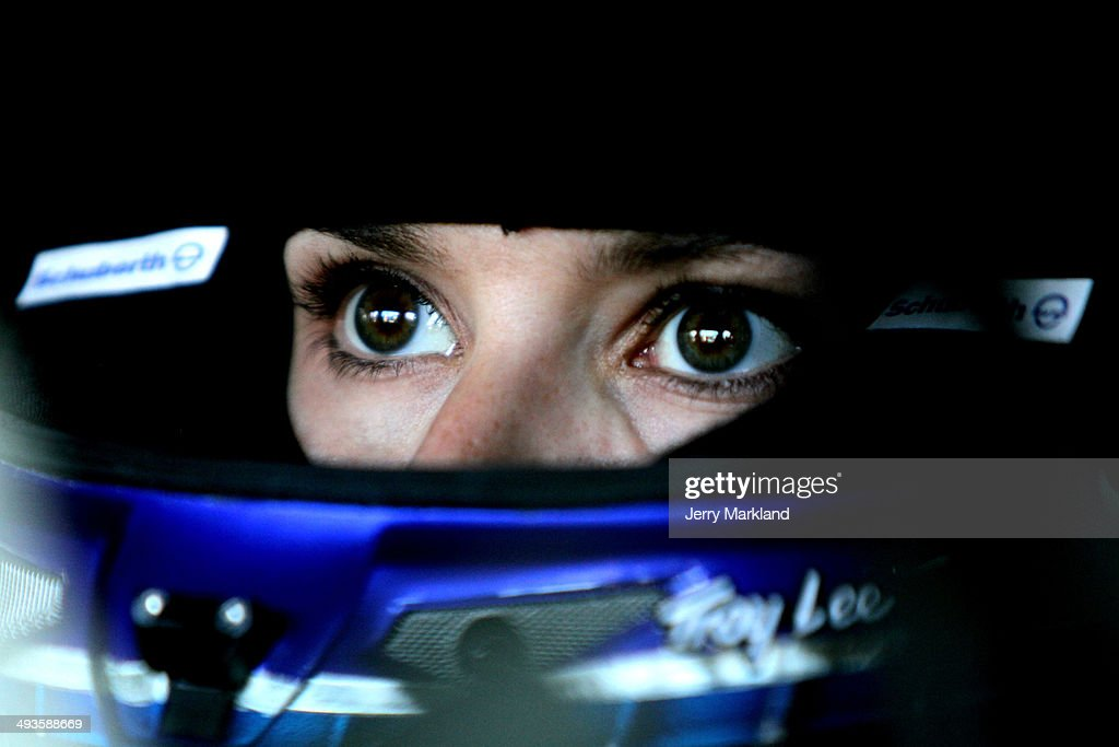 Danica Patrick, driver of the #10 GoDaddy Chevrolet, sits in her car in the garage area during practice for the NASCAR Sprint Cup Series Coca-Cola 600 at Charlotte Motor Speedway on May 24, 2014 in Charlotte, North Carolina.