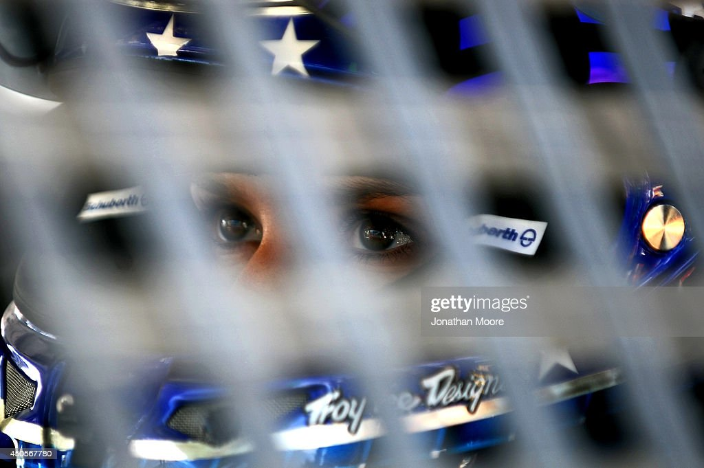 Danica Patrick, driver of the #10 GoDaddy Chevrolet, sits in her car on the grid during qualifying for the NASCAR Sprint Cup Series Quicken Loans 400 at Michigan International Speedway on June 13, 2014 in Brooklyn, Michigan.