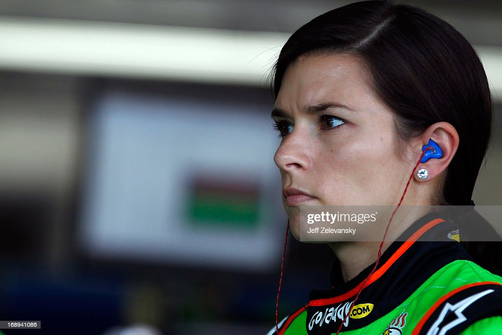 Danica Patrick, driver of the #10 GoDaddy Chevrolet, stands in the garage area during practice for the NASCAR Sprint Cup Series Showdown at Charlotte Motor Speedway on May 17, 2013 in Concord, North Carolina.