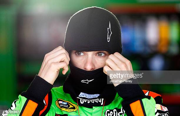 Danica Patrick driver of the GoDaddy Chevrolet stands in the garage area during practice for the NASCAR Sprint Cup Series The Profit on CNBC 500 at...