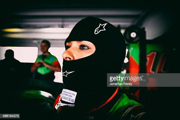 Danica Patrick driver of the GoDaddy Chevrolet stands in the garage area during practice for the NASCAR Sprint Cup Series Ford EcoBoost 400 at...