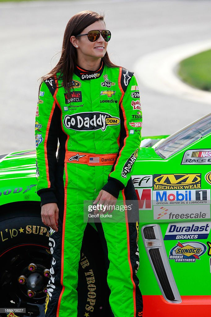 <a gi-track='captionPersonalityLinkClicked' href=/galleries/search?phrase=Danica+Patrick&family=editorial&specificpeople=183352 ng-click='$event.stopPropagation()'>Danica Patrick</a>, driver of the #10 GoDaddy Chevrolet, stands on pit road during qualifying for the NASCAR Sprint Cup Series Showdown at Charlotte Motor Speedway on May 17, 2013 in Concord, North Carolina.