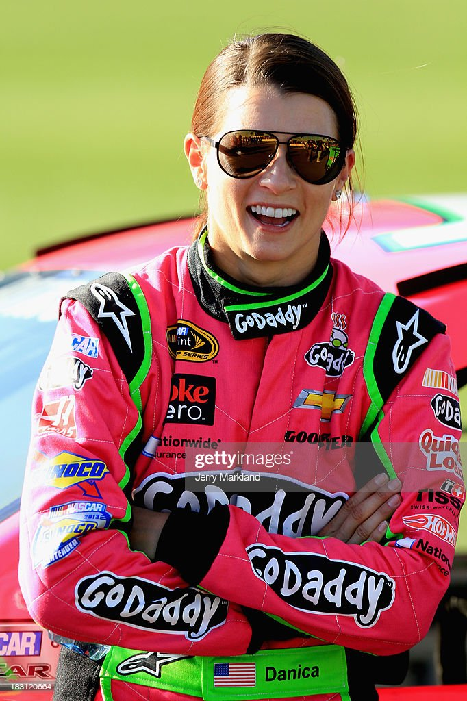 <a gi-track='captionPersonalityLinkClicked' href=/galleries/search?phrase=Danica+Patrick&family=editorial&specificpeople=183352 ng-click='$event.stopPropagation()'>Danica Patrick</a>, driver of the #10 GoDaddy Chevrolet, stands on the grid during qualifying for the NASCAR Sprint Cup Series 13th Annual Hollywood Casino 400 at Kansas Speedway on October 4, 2013 in Kansas City, Kansas.