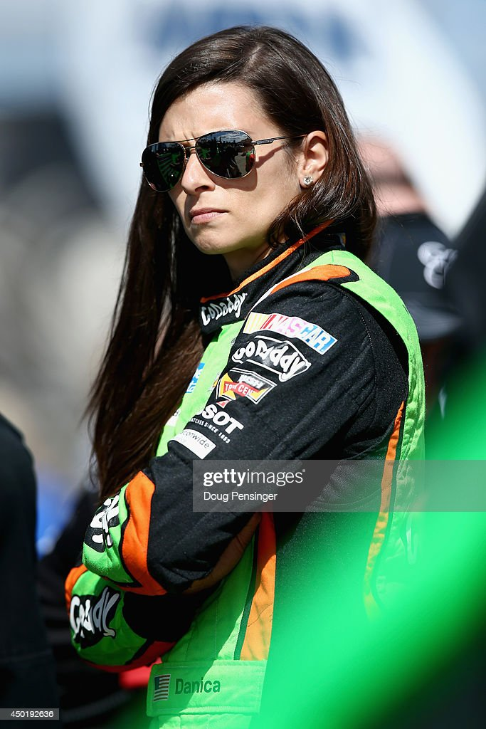 <a gi-track='captionPersonalityLinkClicked' href=/galleries/search?phrase=Danica+Patrick&family=editorial&specificpeople=183352 ng-click='$event.stopPropagation()'>Danica Patrick</a>, driver of the #10 GoDaddy Chevrolet, stands on the grid during qualifying for the NASCAR Sprint Cup Series Pocono 400 at Pocono Raceway on June 6, 2014 in Long Pond, Pennsylvania.