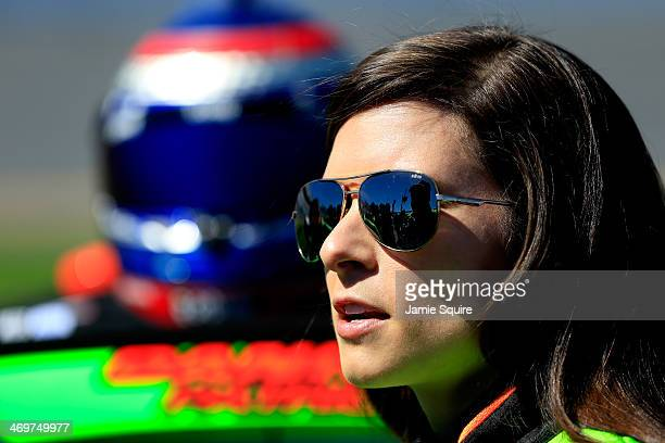 Danica Patrick driver of the GoDaddy Chevrolet stands on the grid during qualifying for the NASCAR Sprint Cup Series Daytona 500 at Daytona...