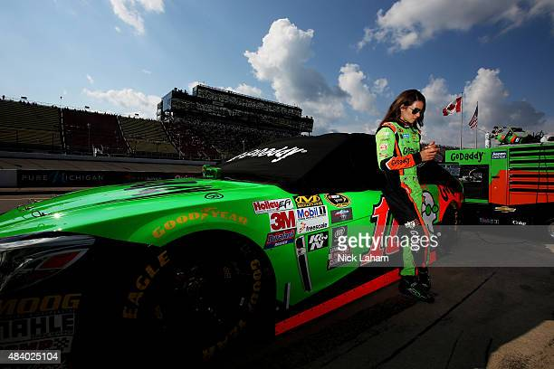 Danica Patrick driver of the GoDaddy Chevrolet stands on the grid during qualifying for the NASCAR Sprint Cup Series Pure Michigan 400 at Michigan...