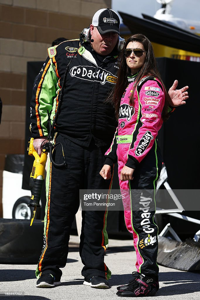Danica Patrick, driver of the #10 GoDaddy Chevrolet, talks to her crew chief Tony Gibson after an on-track inicdent on the first lap of the NASCAR Sprint Cup Series 13th Annual Hollywood Casino 400 at Kansas Speedway on October 6, 2013 in Kansas City, Kansas.