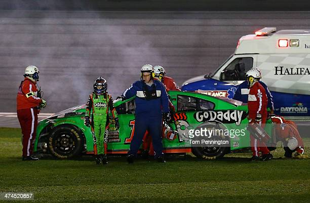 Danica Patrick driver of the GoDaddy Chevrolet walks away from her car after an incident during the NASCAR Sprint Cup Series Daytona 500 at Daytona...