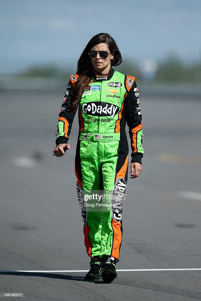 Danica Patrick, driver of the #10 GoDaddy Chevrolet, walks down the grid during qualifying for the NASCAR Sprint Cup Series Pocono 400 at Pocono Raceway on June 6, 2014 in Long Pond, Pennsylvania.
