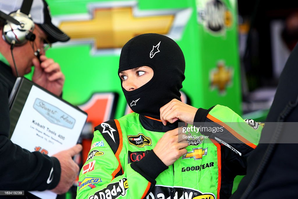 Danica Patrick, driver of the #10 GoDaddy Racing Chevrolet, stands in the garage area during practice for the NASCAR Sprint Cup Series Kobalt Tools 400 at Las Vegas Motor Speedway on March 9, 2013 in Las Vegas, Nevada.