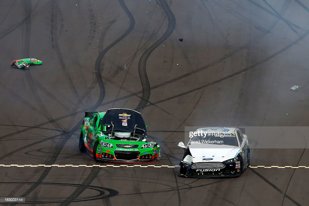 Danica Patrick driver of the GoDaddycom Chevrolet and David Ragan driver of the Ford sit idle on the track after an incident during the NASCAR Sprint...