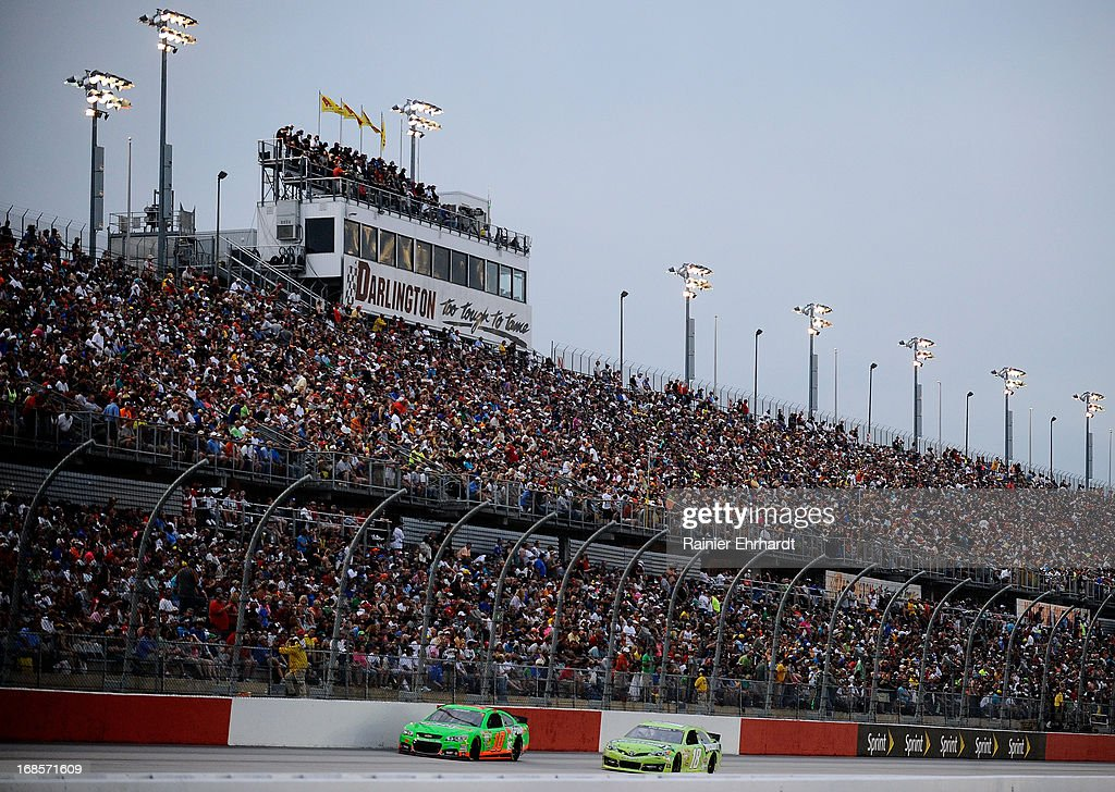 Danica Patrick, driver of the #10 GoDaddy.com Chevrolet and Kyle Busch, driver of the #18 Double Mint Gum Toyota, race down the frontstretch during the NASCAR Sprint Cup Series Bojangles' Southern 500 at Darlington Raceway on May 11, 2013 in Darlington, South Carolina.