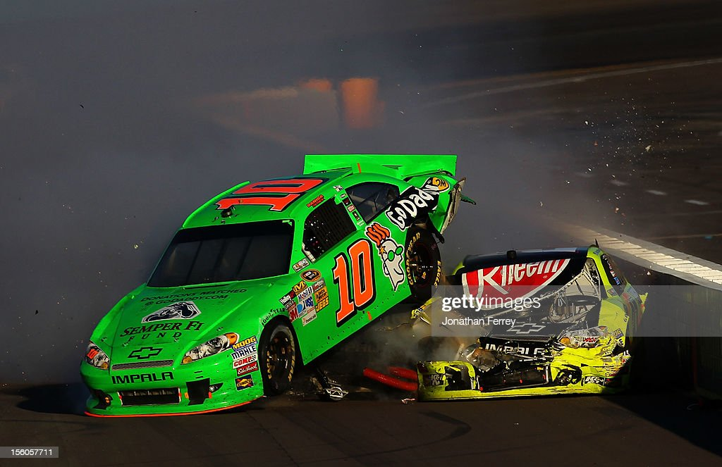 Danica Patrick, driver of the #10 GoDaddy.com Chevrolet, and Paul Menard, driver of the #27 Menards/Rheem Chevrolet, collide on track after an incident in the NASCAR Sprint Cup Series AdvoCare 500 at Phoenix International Raceway on November 11, 2012 in Avondale, Arizona.