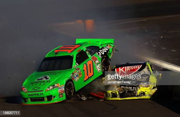 Danica Patrick driver of the GoDaddycom Chevrolet and Paul Menard driver of the Menards/Rheem Chevrolet collide on track after an incident in the...