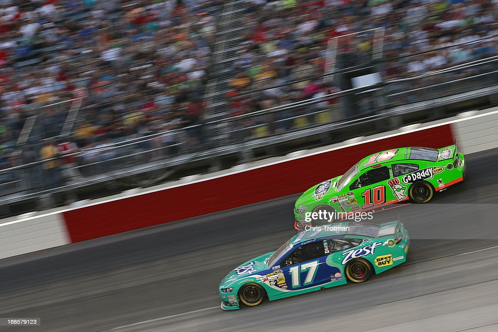 Danica Patrick, driver of the #10 GoDaddy.com Chevrolet and Ricky Stenhouse Jr., driver of the #17 Zest Ford, race side by each during the NASCAR Sprint Cup Series Bojangles' Southern 500 at Darlington Raceway on May 11, 2013 in Darlington, South Carolina.