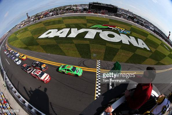 Danica Patrick driver of the GoDaddycom Chevrolet and Trevor Bayne driver of the Motorcraft/Quick Lane Tire Auto Center Ford lead the field to the...