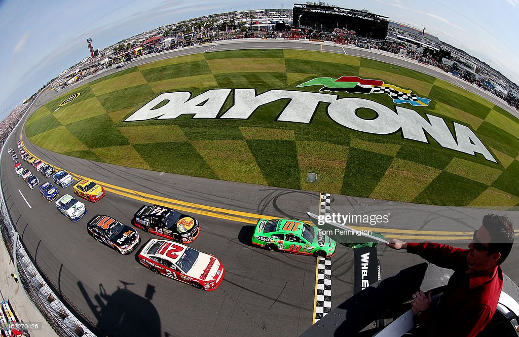 Danica Patrick, driver of the #10 GoDaddy.com Chevrolet, and Trevor Bayne, driver of the #21 Motorcraft/Quick Lane Tire & Auto Center Ford, lead the field to the green flag to start the NASCAR Sprint Cup Series Budweiser Duel 1 at Daytona International Speedway on February 21, 2013 in Daytona Beach, Florida.