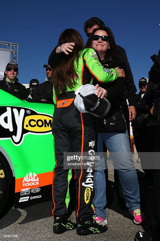 Danica Patrick, driver of the #10 GoDaddy.com Chevrolet, celebrates with Kris Redlinger of GoDaddy.com after winning the pole award for the NASCAR Sprint Cup Series Daytona 500 at Daytona International Speedway on February 17, 2013 in Daytona Beach, Florida.