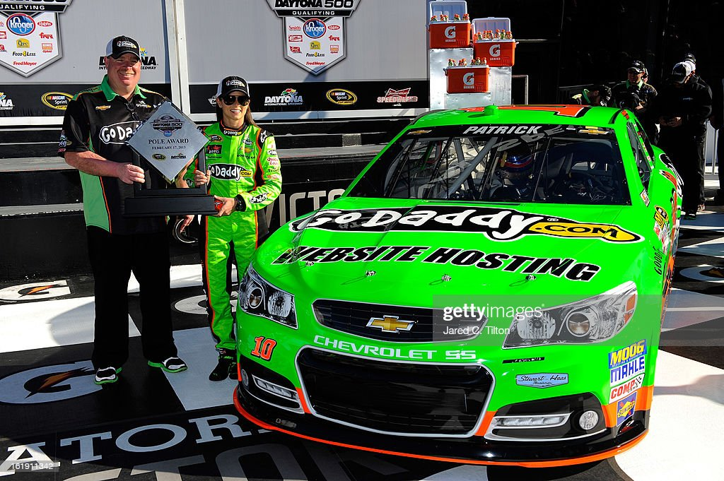 Danica Patrick, driver of the #10 GoDaddy.com Chevrolet, celebrates with crew chief Tony Gibson after winning the pole award for the NASCAR Sprint Cup Series Daytona 500 at Daytona International Speedway on February 17, 2013 in Daytona Beach, Florida.