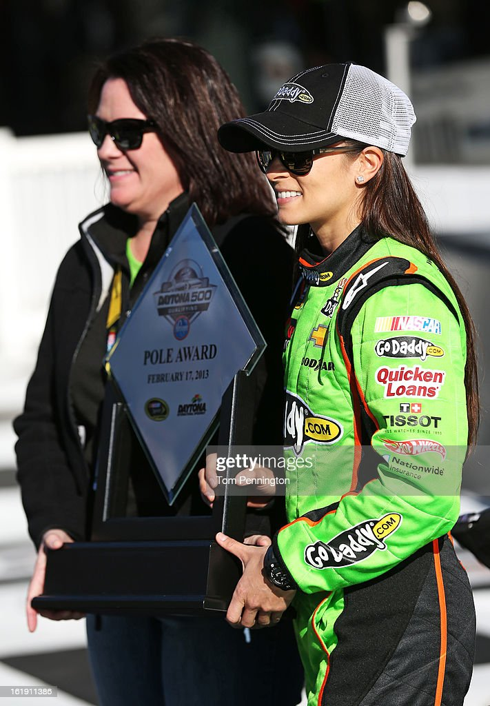 Danica Patrick, driver of the #10 GoDaddy.com Chevrolet, celebrates with Kris Redlinger of GoDaddy.com after winning the pole award for the NASCAR Sprint Cup Series Daytona 500 at Daytona International Speedway on February 17, 2013 in Daytona Beach, Florida.