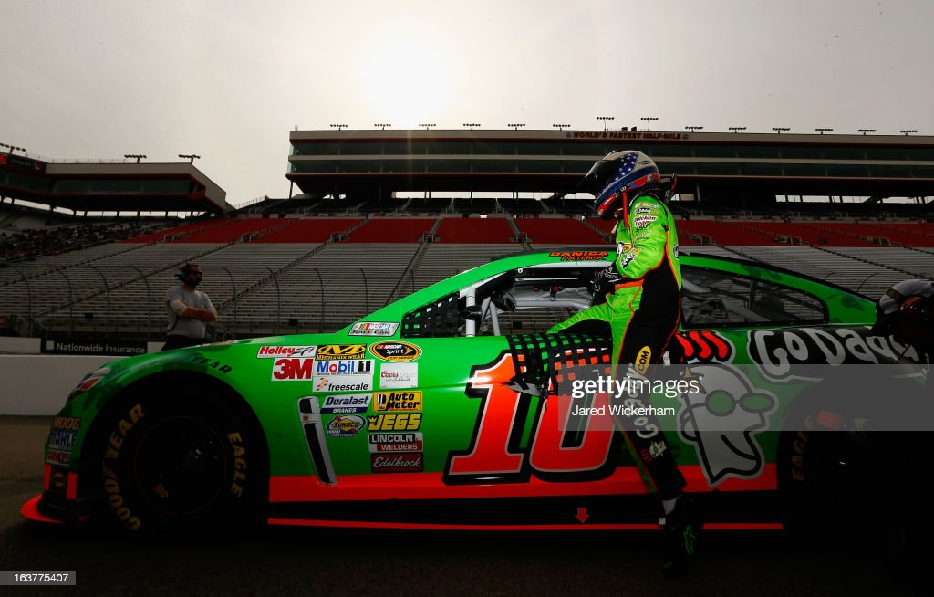 <a gi-track='captionPersonalityLinkClicked' href=/galleries/search?phrase=Danica+Patrick&family=editorial&specificpeople=183352 ng-click='$event.stopPropagation()'>Danica Patrick</a>, driver of the #10 GoDaddy.com Chevrolet, climbs in his car during qualifying for the NASCAR Sprint Cup Series Food City 500 at Bristol Motor Speedway on March 15, 2013 in Bristol, Tennessee.