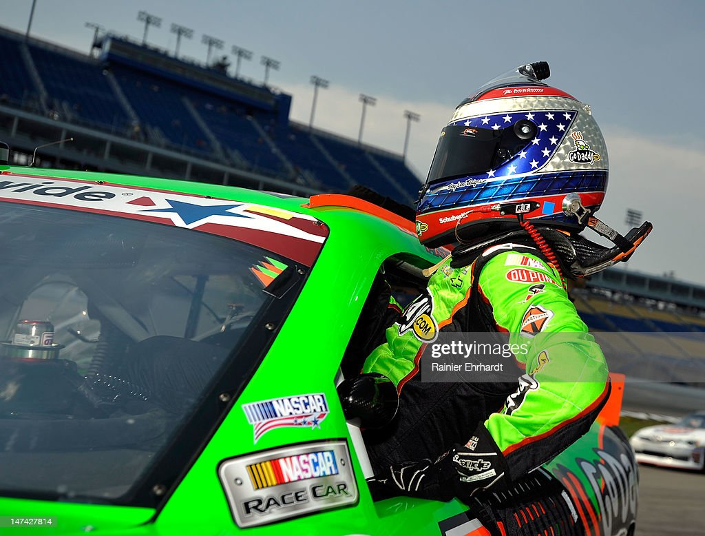 <a gi-track='captionPersonalityLinkClicked' href=/galleries/search?phrase=Danica+Patrick&family=editorial&specificpeople=183352 ng-click='$event.stopPropagation()'>Danica Patrick</a>, driver of the #7 GoDaddy.com Chevrolet, climbs into her car during qualifying for the NASCAR Nationwide Series Feed The Children 300 at Kentucky Speedway on June 29, 2012 in Sparta, Kentucky.