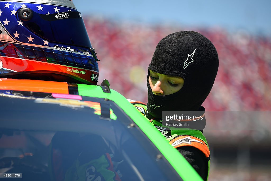 <a gi-track='captionPersonalityLinkClicked' href=/galleries/search?phrase=Danica+Patrick&family=editorial&specificpeople=183352 ng-click='$event.stopPropagation()'>Danica Patrick</a>, driver of the #10 GoDaddy.com Chevrolet, gets in her car during qualifying for the NASCAR Sprint Cup Series Aaron's 499 at Talladega Superspeedway on May 3, 2014 in Talladega, Alabama.