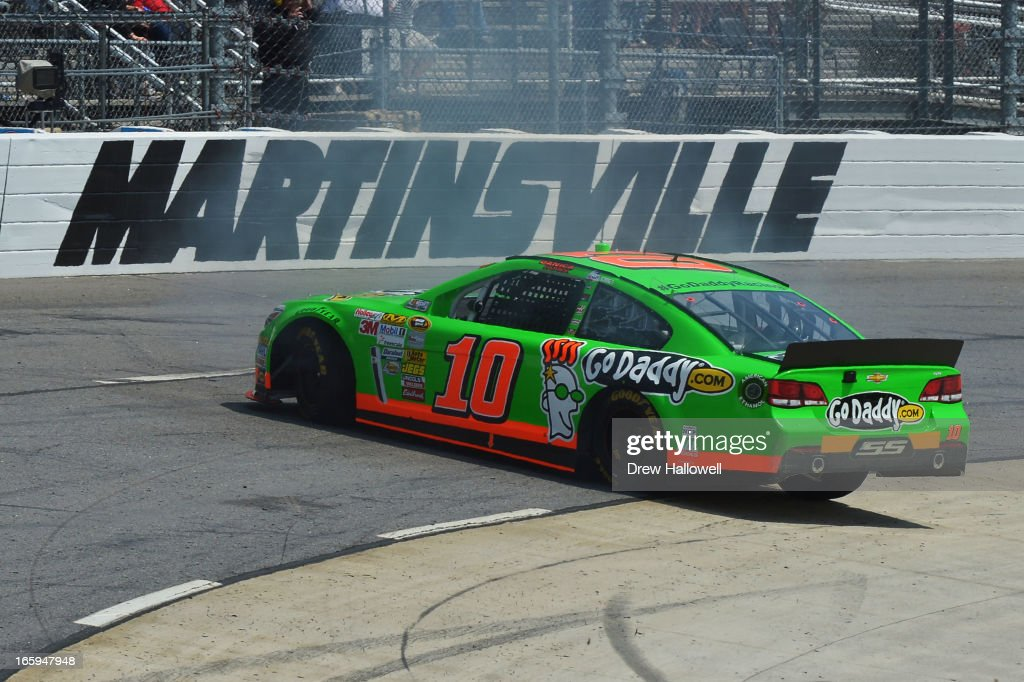 Danica Patrick, driver of the #10 GoDaddy.com Chevrolet, is involved in an incident early in the NASCAR Sprint Cup Series STP Gas Booster 500 on April 7, 2013 at Martinsville Speedway in Ridgeway, Virginia.