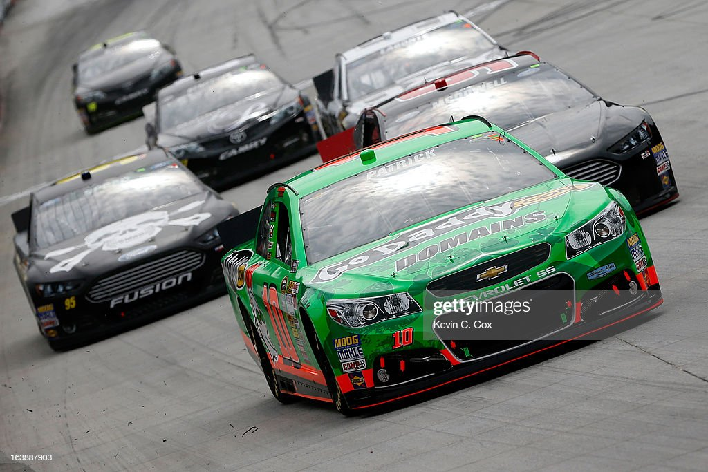 Danica Patrick, driver of the #10 GoDaddy.com Chevrolet, leads a group of cars during the NASCAR Sprint Cup Series Food City 500 at Bristol Motor Speedway on March 17, 2013 in Bristol, Tennessee.