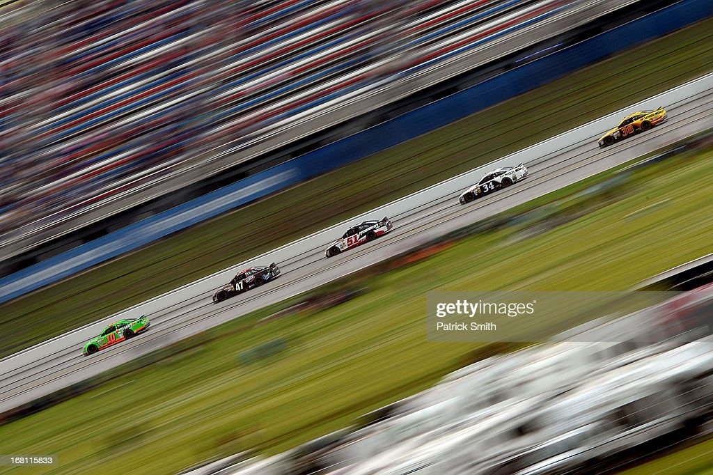 Danica Patrick, driver of the #10 GoDaddy.com Chevrolet, leads cars down the backstretch during the NASCAR Sprint Cup Series Aaron's 499 at Talladega Superspeedway on May 5, 2013 in Talladega, Alabama.