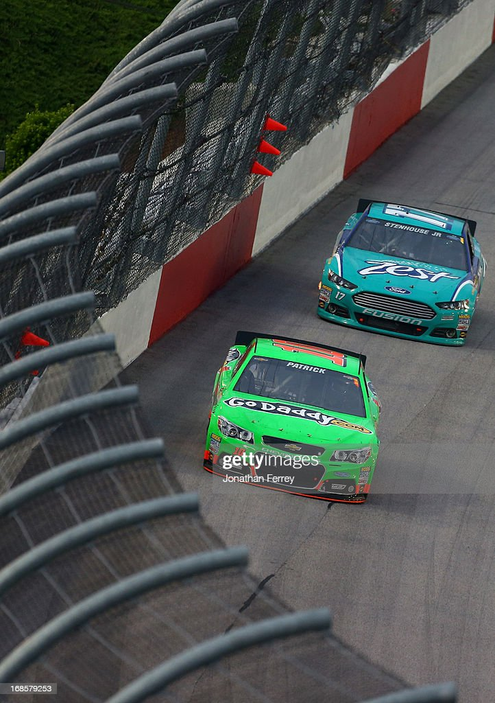 Danica Patrick, driver of the #10 GoDaddy.com Chevrolet, leads Ricky Stenhouse Jr., driver of the #17 Zest Ford, during the NASCAR Sprint Cup Series Bojangles' Southern 500 at Darlington Raceway on May 11, 2013 in Darlington, South Carolina.