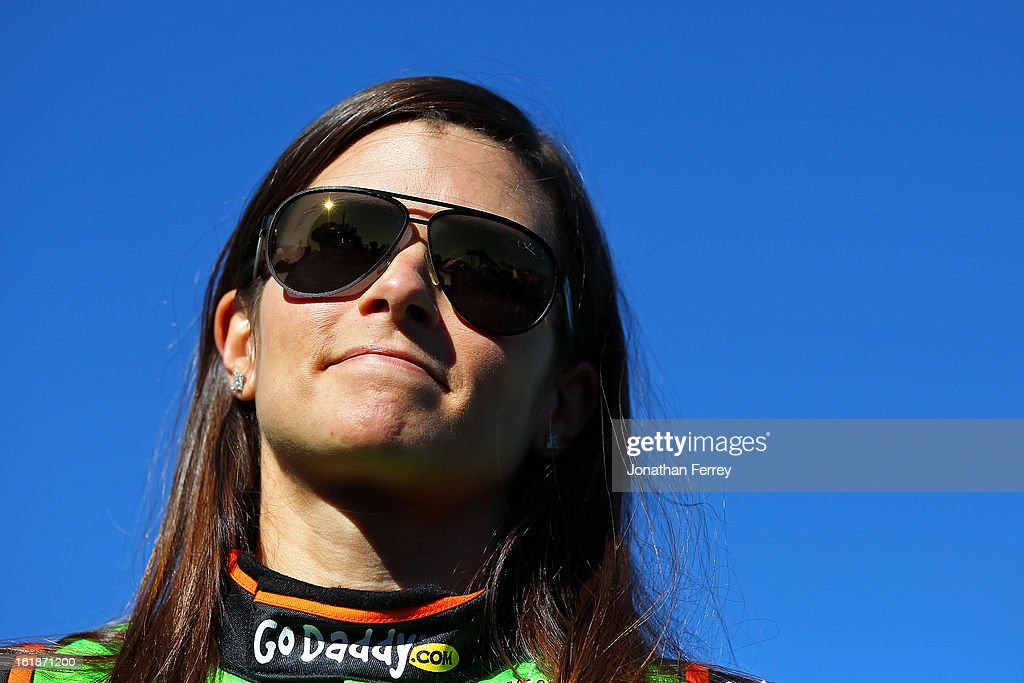<a gi-track='captionPersonalityLinkClicked' href=/galleries/search?phrase=Danica+Patrick&family=editorial&specificpeople=183352 ng-click='$event.stopPropagation()'>Danica Patrick</a>, driver of the #10 GoDaddy.com Chevrolet, looks on after qualifying for the NASCAR Sprint Cup Series Daytona 500 at Daytona International Speedway on February 17, 2013 in Daytona Beach, Florida.
