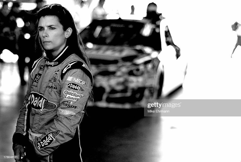 <a gi-track='captionPersonalityLinkClicked' href=/galleries/search?phrase=Danica+Patrick&family=editorial&specificpeople=183352 ng-click='$event.stopPropagation()'>Danica Patrick</a>, driver of the #10 GoDaddy.com Chevrolet, looks on during qualifying for the NASCAR Sprint Cup Series Coke Zero 400 at Daytona International Speedway on July 5, 2013 in Daytona Beach, Florida.