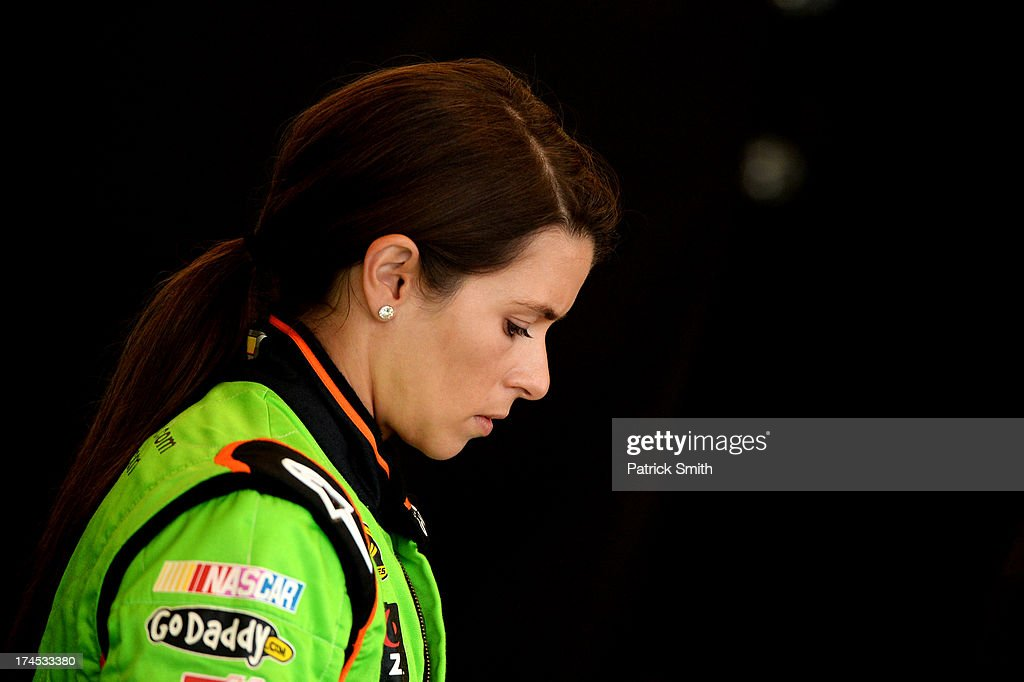 <a gi-track='captionPersonalityLinkClicked' href=/galleries/search?phrase=Danica+Patrick&family=editorial&specificpeople=183352 ng-click='$event.stopPropagation()'>Danica Patrick</a>, driver of the #10 GoDaddy.com Chevrolet, looks on during practice for the NASCAR Sprint Cup Series Samuel Deeds 400 At The Brickyard at Indianapolis Motor Speedway on July 27, 2013 in Indianapolis, Indiana.