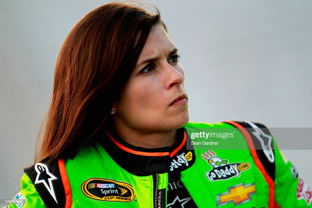 Danica Patrick, driver of the #10 GoDaddy.com Chevrolet, looks on during qualifying for the NASCAR Sprint Cup Series AdvoCare 500 at Atlanta Motor Speedway on August 30, 2013 in Hampton, Georgia.