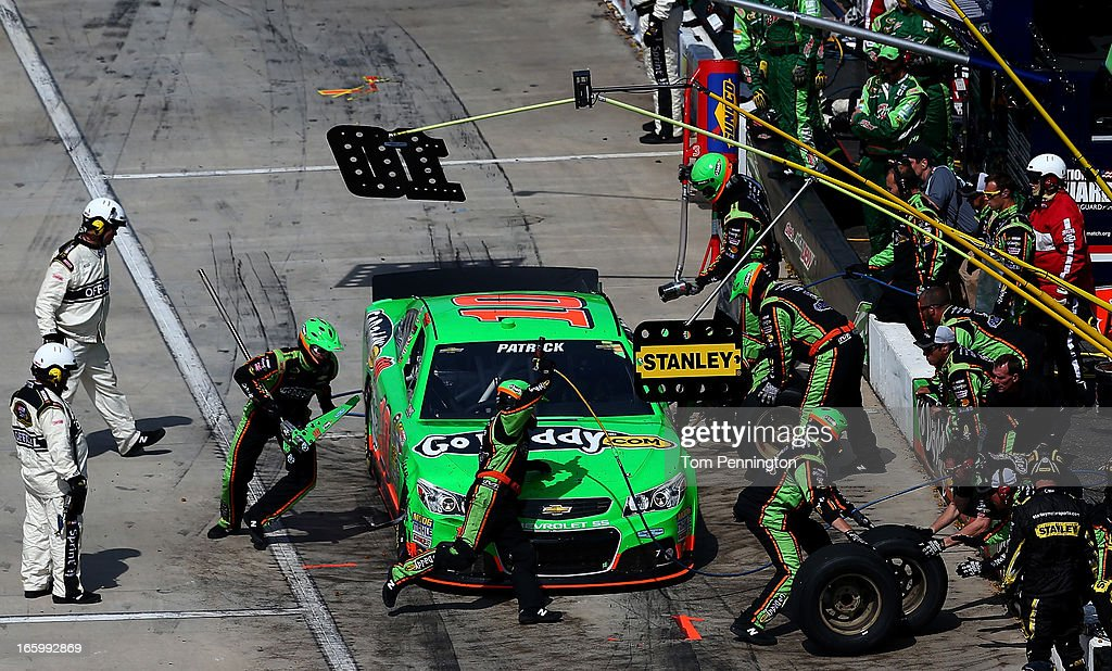 Danica Patrick, driver of the #10 GoDaddy.com Chevrolet, makes a pit stop during the NASCAR Sprint Cup Series STP Gas Booster 500 on April 7, 2013 at Martinsville Speedway in Ridgeway, Virginia.