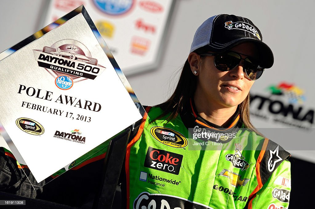 <a gi-track='captionPersonalityLinkClicked' href=/galleries/search?phrase=Danica+Patrick&family=editorial&specificpeople=183352 ng-click='$event.stopPropagation()'>Danica Patrick</a>, driver of the #10 GoDaddy.com Chevrolet, poses after winning the pole award for the NASCAR Sprint Cup Series Daytona 500 at Daytona International Speedway on February 17, 2013 in Daytona Beach, Florida.